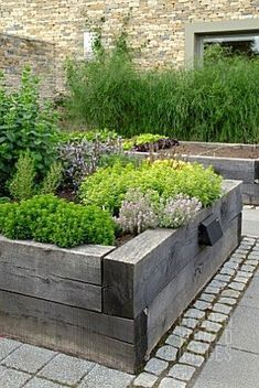 Contemporary raised beds - beautiful distressed beams. #contemporarygardenfurniture #contemporaryraisedbeds