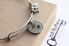 Vintage Buffalo, NY transit token on a matte antique silver/pewter-color bracelet with 716 charms.    >>> PLEASE NOTE: The first 3 pictures show the