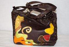 in brown faux leather fabric bag with non-conventional design