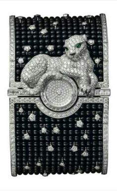 Panthère cuff watch, white gold, onyx, diamonds, emeralds | Cartier | cynthia reccord