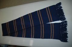 Ravenclaw scarf. Not-quite-navy blue, brassy stripes-- not gold and not copper.
