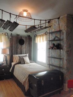 Idea for boys' adventure themed room- Maps for wallpaper, barn door for headboard, name written in rope, antique suticases for nightstand