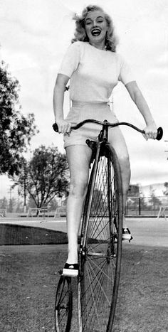 1949. Marilyn Monroe at the Fourth Annual Pacific Coast Antiques Show, May 1949. Bicycle Ride. Photo by Ed Baird.