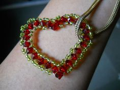 DIY Beaded Heart Shaped Pendant by www.instructables.com. Instructions so detailed I think even I can make it!
