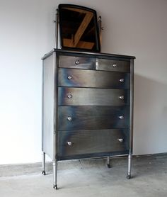 My current project...so exciting. Refinishing my bf's metal dresser!!