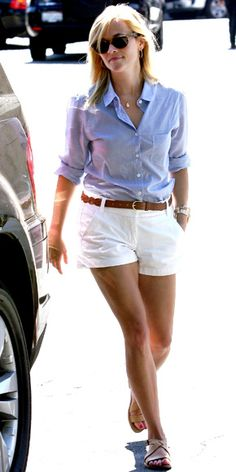 white shorts paired with cuffed blouse