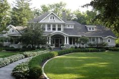 I like the layered plants outlining the walkway. Looks like hostas and boxwoods. Also, love the home exterior.
