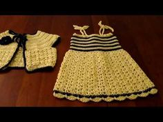 Crochet child sundress and matching bolero. Cute set. The patterns are not included, but the bolero is a free pattern from Lions Brand 80023AD.