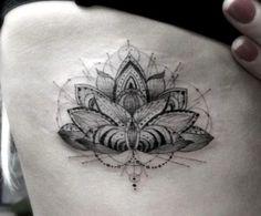 Geometric lotus done on Ellie Goulding by Doctor Woo