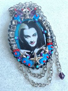"""""""Naughty-cal Lily Munster""""  beaded pendant with stars, rhinestones and skull and crossbones...  createdby Create Beautiful Beads on facebook"""