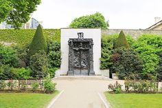 MUSEUM RODIN, PARIS: The Gates of Hell, based on Dante's Divine Comedy, is located at the end of the walled garden. Rather than closing off the space, it hints at another beyond.