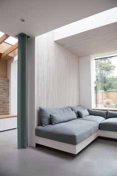 combo of concrete, brick and wood AL Studio 1 Architects has added a brick extension with a large window to the rear of this Victorian house in London, creating a light-filled seating area clad in white-washed ash slats. Built In Sofa, Built In Seating, Interior Architecture, Interior And Exterior, Interior Design, Commercial Architecture, Residential Architecture, Brick Extension, Glass Extension