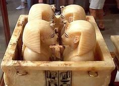 Tutankhamun's canopic chest and lids in the form of human heads