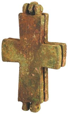 Ancient Byzantine  bronze cross-shaped reliquary with an image to front side, a hinge to the top, incised/circular patterns to the surface. The piece opens.  640 AD
