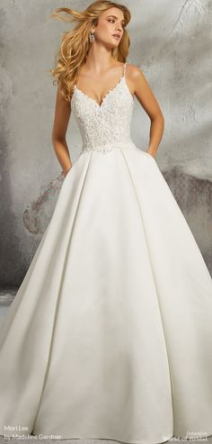 Classic duchess satin ballgown featuring a feminine, beaded alençon over chantilly lace bodice. This beautiful spaghetti strap luella wedding dress features stunning lace and beading on an intricately designed satin gown. Classic Wedding Dress, Wedding Dress Styles, Dream Wedding Dresses, Bridal Dresses, Mori Lee Wedding Dress, Deb Dresses, Wedding Kimono, Satin Blazer, Wedding Gown Ballgown