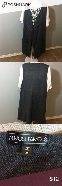 """Long Sweater Vest Long sweater vest with flyaway opening and pockets. In good used condition- no pulls. Measures 18"""" armpit to armpit and 33"""" length. Almost Famous Jackets & Coats Vests"""