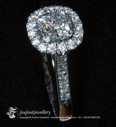Platinum and Diamond Engagement ring set with E colour cushion cut centre stone. By Lorcán Field