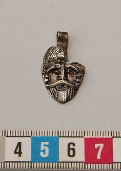 Viking age silver antropomorphic pendant, Birka, Sweden.