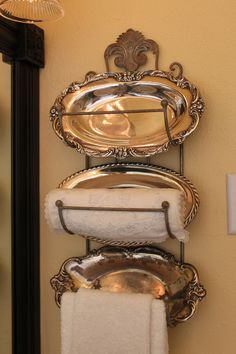If you come across some silver platters, simply place them on a plate rack, add towels and you instantly have a chic French Country Cottage look! Now I want some silver platters!