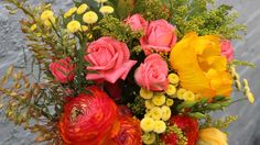 Roses and rananculus in bright spring colours for an eye catching spring wedding bouquet, by east London florist Hiding in the City Flowers