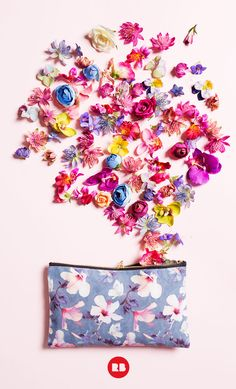 Stash your pencils, makeup, or tiny treasures in this pretty pouch featuring hibiscus flowers and butterflies.
