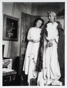 Chattie Salaman and Vanessa Bell posing in costume for the Berwick Church Murals in 1940. The murals were a commission which Duncan Grant and Vanessa Bell worked on between 1940 and 1942, with the help of Vanessa's children Angelica and Quentin.
