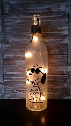 A 12 frosted wine bottle with Joe Cool , Snoopy A set of set of lights run through the back and plug in Twine at the top is removable, or if you would rather have a colored ribbon just message me during check out *ready to ship