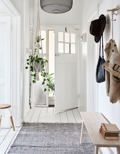 The beautiful hallway and front door of Lynda's third floor apartment. 'The wonderful thing about old apartments,' tells Lynda, 'is the high ceilings and spacious rooms – even the hallway is roomy!' Photo – Eve Wilson for The Design Files.