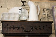 old sewing machine drawer becomes a shelf, with a board added to the top