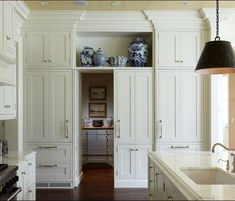 There is nothing I love more than a classic white kitchen . except for a classic white kitchen with blue and white accessories! White Shaker Kitchen, Classic White Kitchen, Timeless Kitchen, Hidden Pantry, Hidden Cabinet, Hidden Storage, Harrison Design, Cocinas Kitchen, Custom Builders