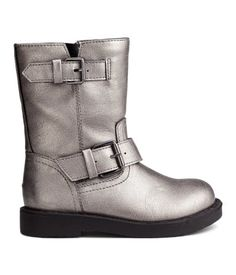 Brushed gold-color. Biker boots in imitation leather. High leg section with a small elastic panel at top, adjustable straps with metal buckles, and zip and