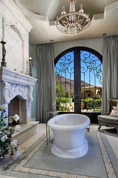 Beautiful Master Bath with limestone fireplace. This, is almost THE perfect bathroom. Tub needs to be square and sunken...like a Grecian bathhouse
