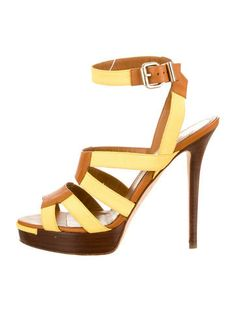 Yellow Fendi sandals with gold-tone buckle closure at side. $175