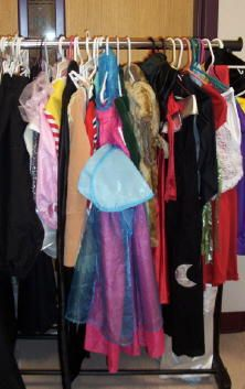costume shop at halloween (ask parents to donate old costumes, purchase them at good will or at clearance prices)