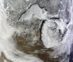 Image from NASA's Terra Satellite showing lake effect snow blowing across Michigan, Jan. 22, 2013.
