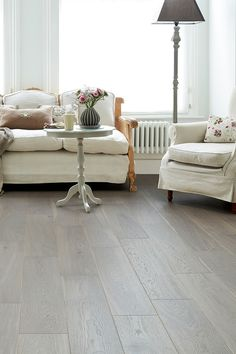 Give a period living room scheme a modern update with on-trend grey wood flooring. Home Choice Engineered European Rustic Oak Flooring 14mm X 180mm Paloma Grey Lacquered is a textured engineered oak floor wutg dark smokey grey tones and a lively rustic grain that's sure to demand attention. #flooring #floors #open #house #floor #plans #engineered #real #wood #rustic #contemporary #design #grey #greys Grey Wood Floors, Solid Wood Flooring, Engineered Wood Floors, Luxury Vinyl Flooring, Timber Flooring, Grey Flooring, Flooring Ideas, Living Room Flooring, Living Room Interior