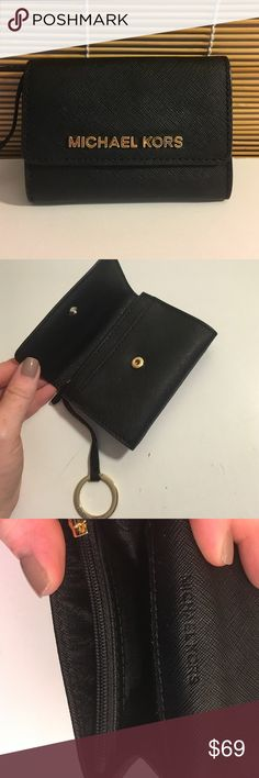 MK wallet NWOT Black saffiano leather Michael Kors wallet with zipper change pouch and button closure with gold hardware and keychain attachment. New without tags. GOLD1429 Michael Kors Bags Wallets