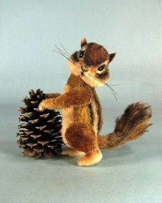 This chipmunk is a movement animal! My movement animals have 6 joints, an independent neck, armature and are designed to pose in many ways including standing upright, standing on four legs, laying, etc. Besides being adorable, this chipmunk is very versatile! To make things even
