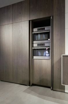 Hid your oven stack behind tall pocket doors.  Kitchen Design Think Tank