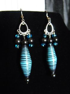 """I made these paper beads from cardstock.  I handpainted the edges black for a contrast in color.  Accented with glass beads.  $9.00 Approx. 3"""" in length. One of a kind."""