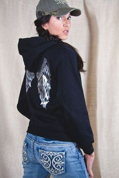 Country Girl ® Angel Wings Relaxed Pullover Hoodie - Country Fashion Clothing | This Country Girl ® hoodie features silver fashion foil. Our women's Pullover Hoodie features a relaxed fit, a double-lined hood with matching drawstring. The hoodie is made with 7.75 oz. 50% cotton/50% polyester and has double-needle stitching throughout. Spandex is used in the waistband and the cuffs are 1x1 rib knit.