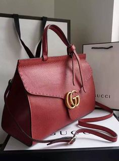 The antique gold toned metal pieces, top-stitching detail and the Gucci well known double G closure make an appealing contrast. See more designer bags at http://www.luxtime.su/