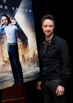James McAvoy in front of his character poster from Days of Future Past