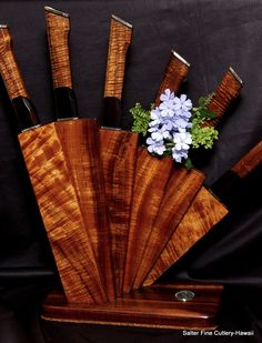 Hand-forged chef knives with decorative handles in matching koa wood 'fan' stand. Original art for the kitchen by Gregg Salter. www.SalterFineCutlery.com