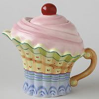 After all the teapot cupcakes, finally a cupcake teapot.  This is very chic, and looks well designed.