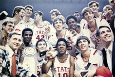 NC State basketball team with the NCAA trophy (1974)