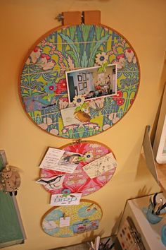 I love this idea! Adding embroidery hoops to my list of things to look for at garage sales/thrift shops.