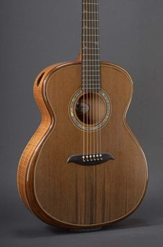 Micheletti Guitars - hand-made signature acoustic guitars and custom stringed instruments.