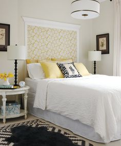 Wallpaper headboard, then adding a white frame for a focal point. I also adore the lamps and the pops of yellow.