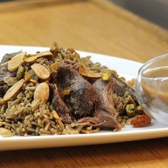We have always heard of Bulgur Bi Dfeen. How about replacing bulgur with rice?